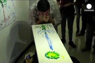 WATCH: Artist Who Paints With Eyes Wants To Create NFTs