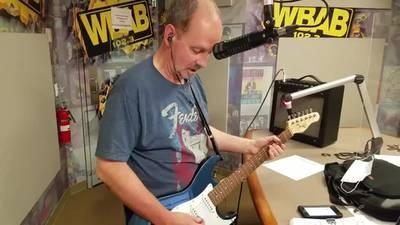 Watch Roger play guitar live in studio